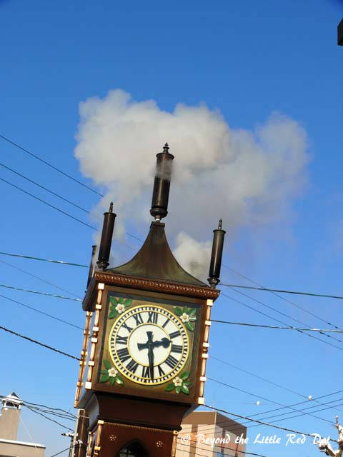 There is a steam powered clock just outside the Music Box Museum.