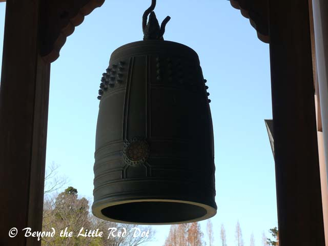 A huge bell hanging from the door frame.