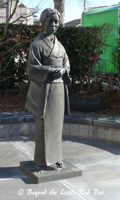I'm not sure what this statue is but I think its Oshin, the long suffering daughter-in-law in Japanese history.