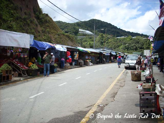 One of the several markets that line the side of the road. Locals and tourists come here to bargain buy local produce.