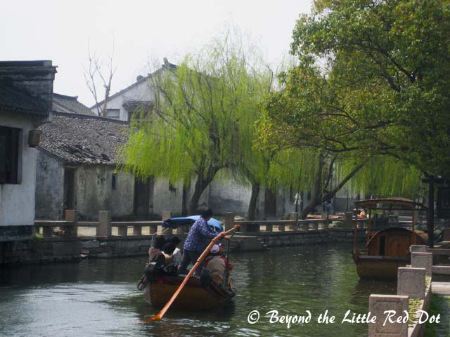 The village is surrounded by canals with willow trees along the sides. Definitely, the classical type of Chinese scenery.