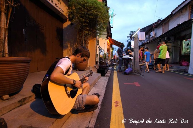 I met this guy who was sitting there and playing his guitar. He's a Canadian student who is waiting to enter university. He worked for 1 year to save up for a 6 months holiday in South East Asia before starting school. Best of luck mate!