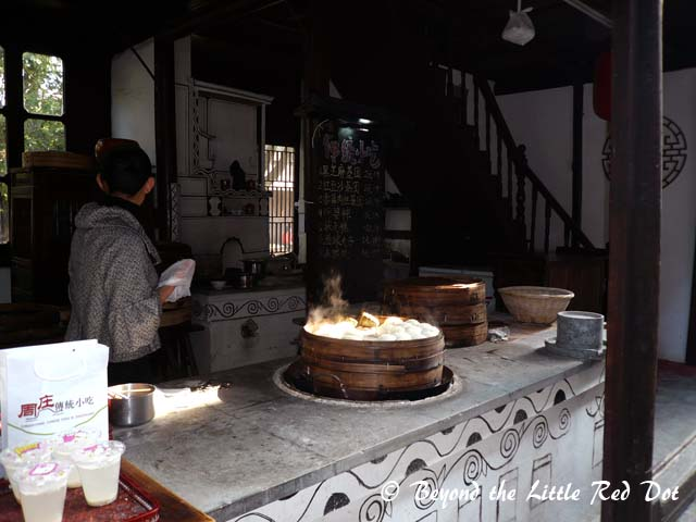 Amongst the buildings, you have many shops selling Chinese snacks, home brewed rice wine, souvenirs and handicrafts.