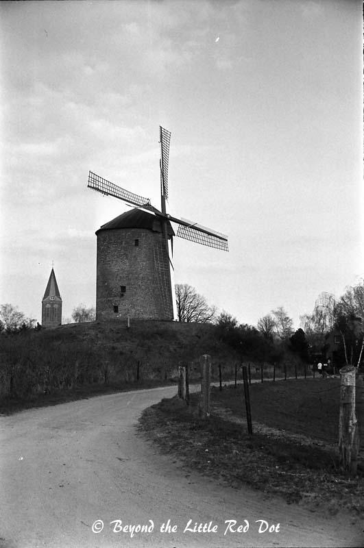 A medieval windmill scene.
