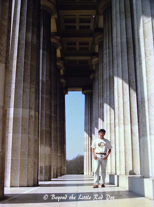 Standing amongst the massive Greek columns.