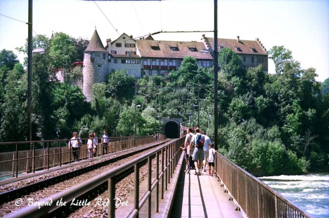 The rail bridge crossing the river. There is a castle that on the right bank of the river that you can visit.