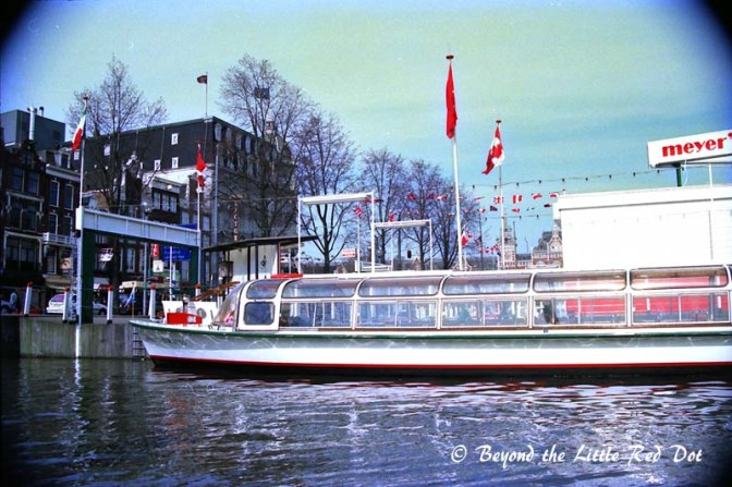 One of the many canal cruise boats that you can book to travel the canals in comfort.