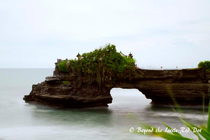 Another long exposure shot with a rock arch on the other side of Tanah Lot.