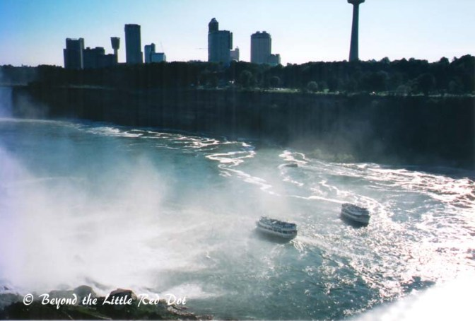 The boats that bring tourists to the edge of the falls. The buildings and the far side are actually in Canada.
