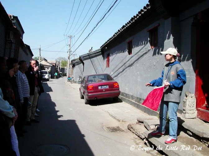 Our guide explaining the history and significance of the architectural elements in the hutong.