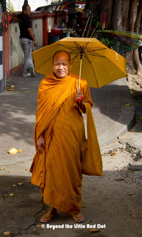 I bumped into this monk along the street and he obliged for a photo. Note the matching umbrella and his robes.