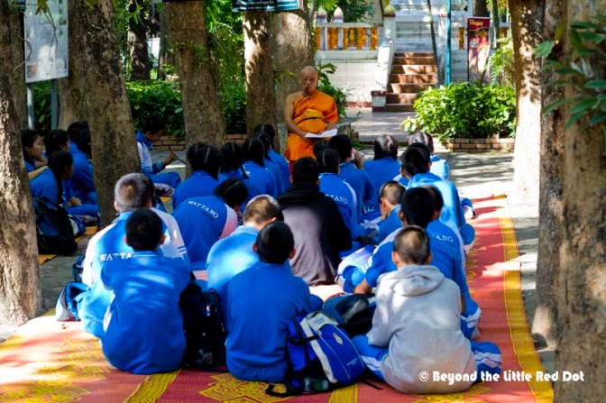 An open air classroom. It was a lively discussion between students and monk.