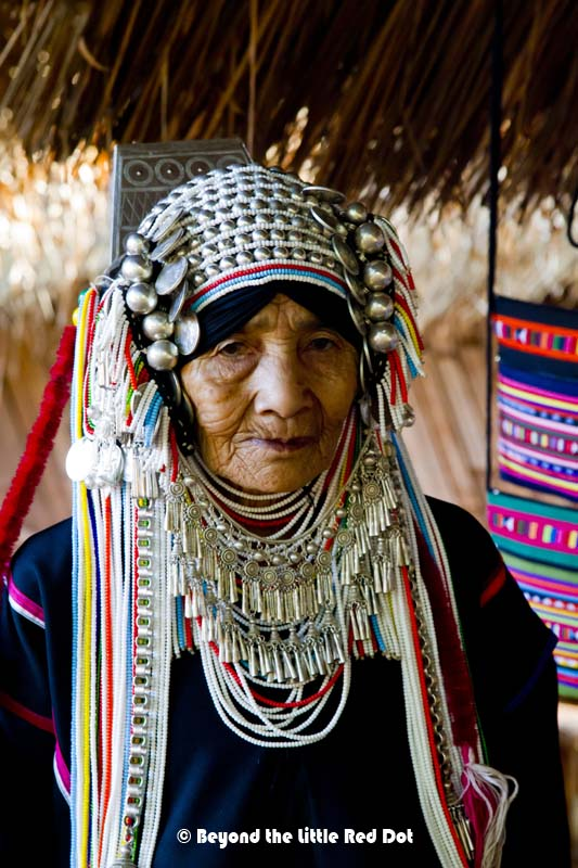 An Akha hill tribe woman and her very elaborate head dress. The style and design of the head dress defines her age and marital status.