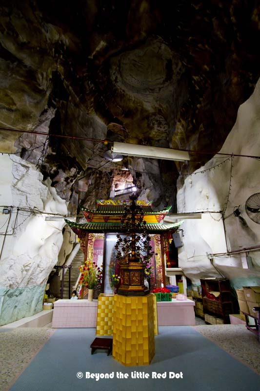 inside the cave, you will find several Buddhist shrines.