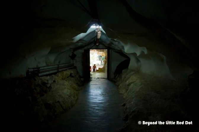 Following the cave to the back, there is a tunnel that leads to an opening inside the limestone hills.