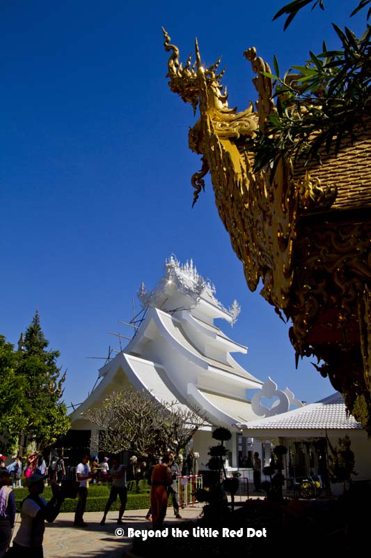 White and gold. The temple grounds are crowded with visitors.