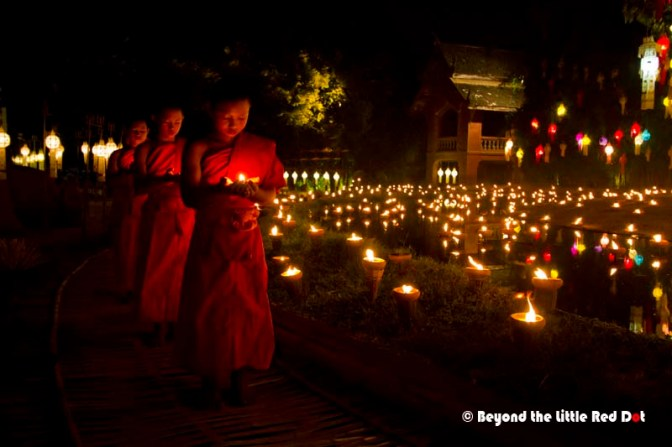 The novice monks now came in, each holding an oil lamp and praying.