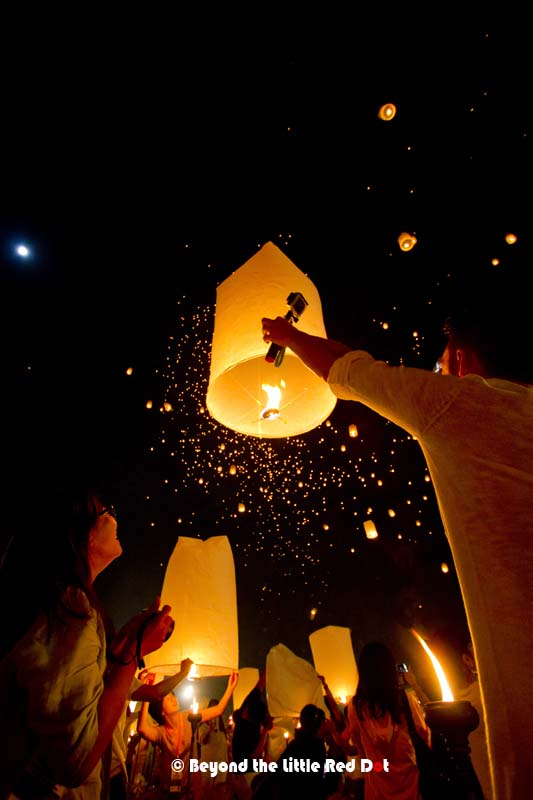 A couple release their sky lantern.