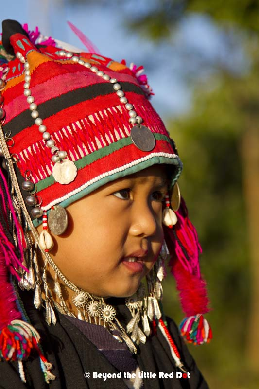 An Akha child in her traditional dress.