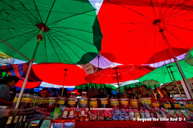 Colorful umbrellas form the roof of the market.