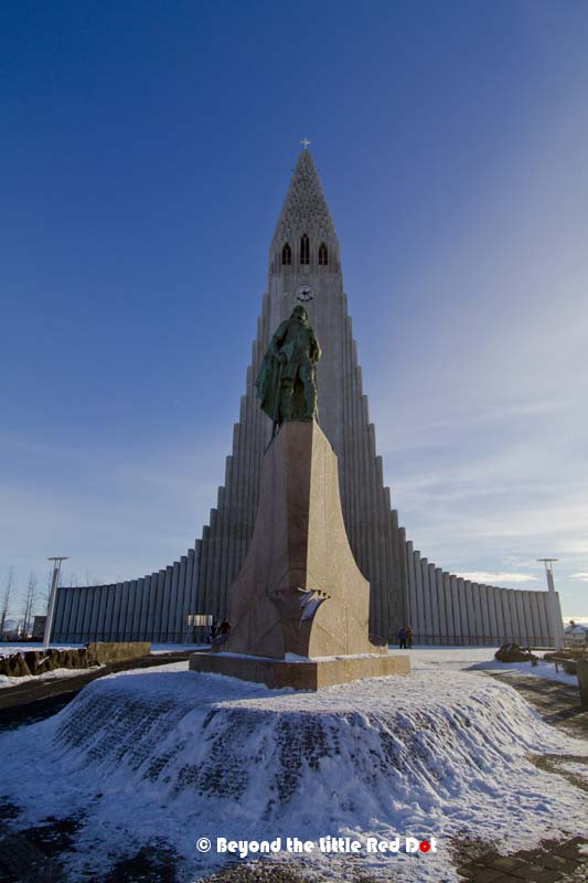A statue of Leifur Eiríksson stands in front of Hallgrimskirkja. He was the first Viking who discovered America. The statue was gift from the USA to Iceland.