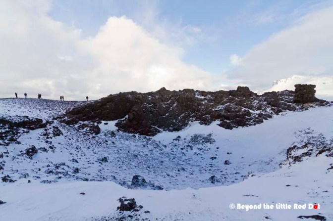 Once at the summit we could look into the crater, which was already filled with snow and loose rock.