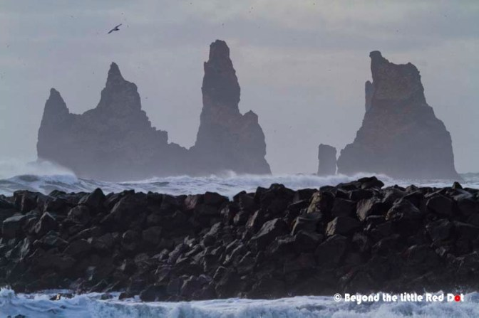 Volcanic rocks called basalt form rock formations in the sea.