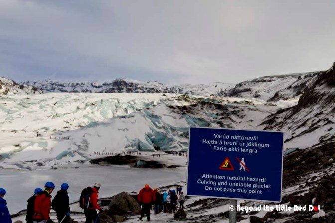 Despite the sign, tourists were walking down onto the glacier. Some groups were led by experienced staff and wearing proper ice boots and sticks. But a lot were also just casual tourists like us.