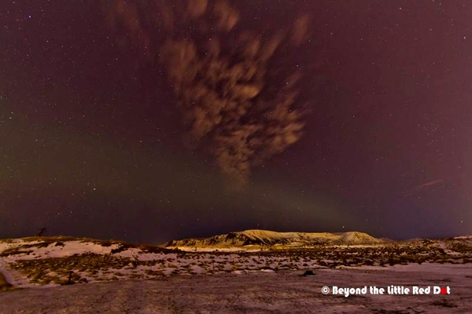 We couldn't see it with our naked eyes but a long exposure caught faint Aurora activity.