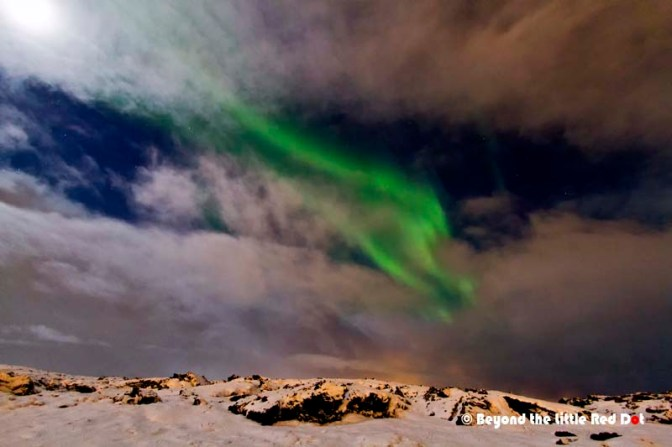 Cloudy skies doesn't mean all is lost. There are breaks in the clouds where you can still see the Aurora.