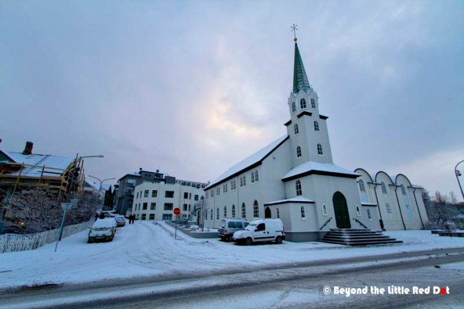 Our service apartment is the white building located behind the church. It's conveniently located and only 10 minutes walk to Reykjavik town center.