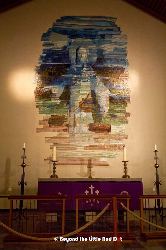 The altar is especially pretty as it has a modern art painting of Jesus rather than the traditional crucifix.