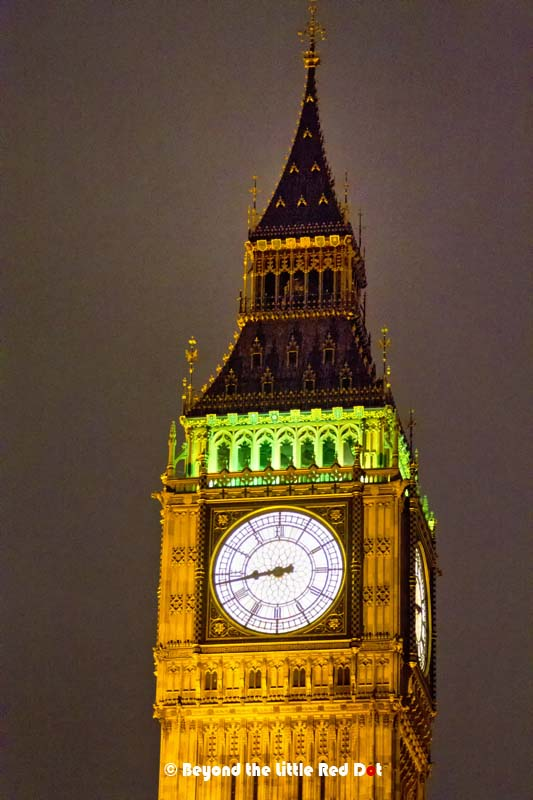 A close up of Big Ben and it's intricate clock face and architecture.