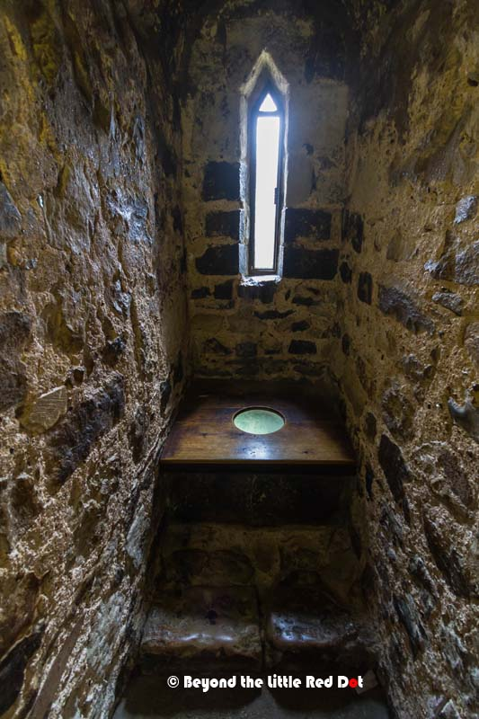 An ancient toilet. It's built on an overhang so that your waste drops outside the walls.
