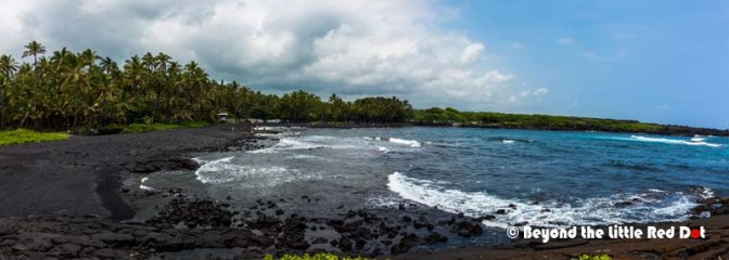 The black sand is from the volcanic rocks that have eroded.