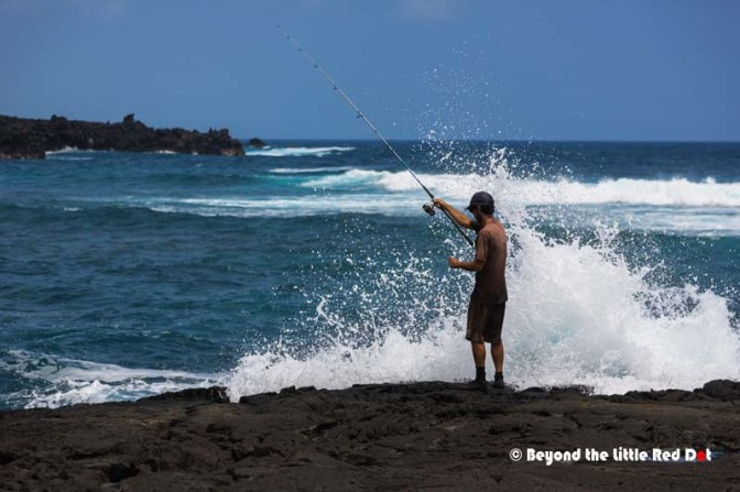 A fisherman at the black sand beach.