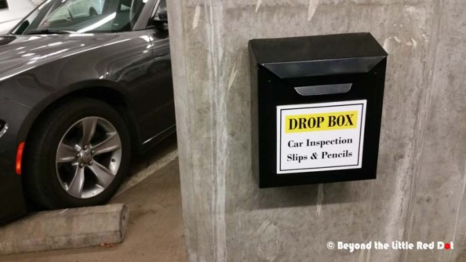 After paying, you collect your car from the parking lot. Unlike Asia, nobody goes with you to check the car. You have to check the car for any damages yourself, fill in the pre-inspection form and drop it in the black boxes shown above.