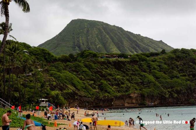 On the beach of Hanauma Bay, where you can see Koko Crater, another volcanic cone.