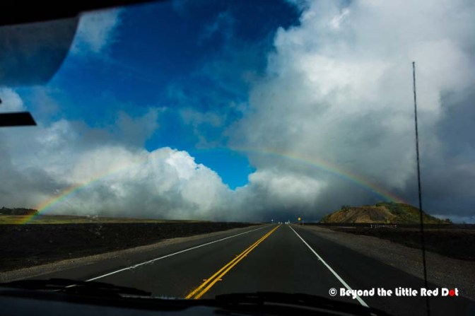 The weather was cloudy and raining in the foothills but cleared up by the time we got higher. This beautiful rainbow appeared in front of our bus.