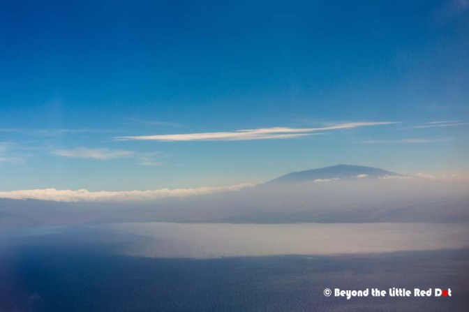 Our first sight of Big Island is the imposing silhouette of Mauna Loa above the clouds.
