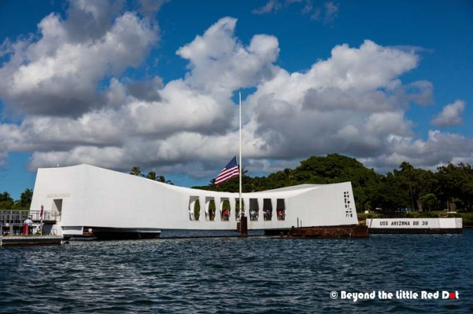 The USS Arizona memorial which straddles across the wreck of the battleship that sank during the attack on Pearl Harbor. More than a thousand sailors died that day and their bodies are still trapped underwater.